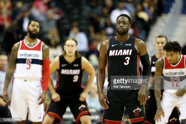 Dwyane Wade of the Miami Heat looks on against the Washington Wizards during the first half of a preseason NBA game at Capital One Arena on October 5...