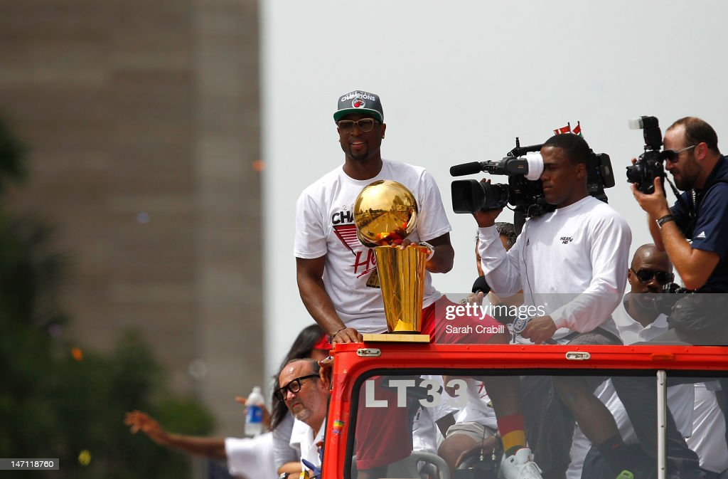 Dwyane Wade of the Miami Heat looks on during a celebration parade for the 2012 NBA Champion Miami Heat on June 25, 2012 in Miami, Florida.
