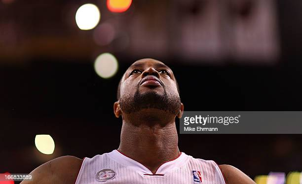 Dwyane Wade of the Miami Heat looks on during a game against the Orlando Magic at American Airlines Arena on April 17 2013 in Miami Florida NOTE TO...