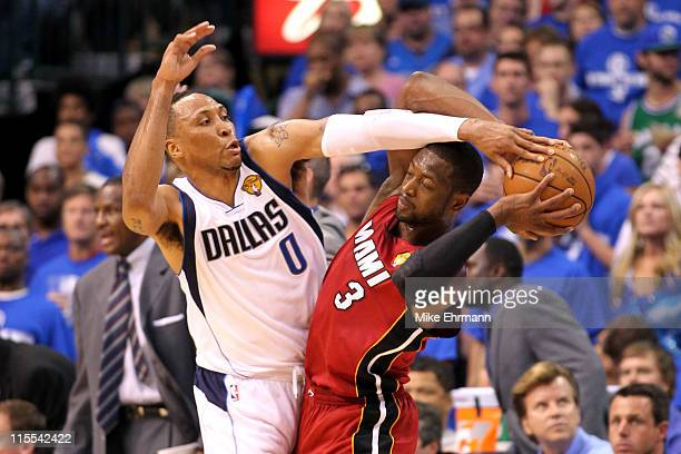 Dwyane Wade of the Miami Heat looks to pass against Shawn Marion of the Dallas Mavericks in Game Four of the 2011 NBA Finals at American Airlines...