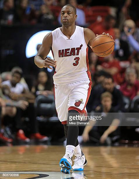 Dwyane Wade of the Miami Heat looks to pass during a game against the New York Knicks at American Airlines Arena on January 6 2016 in Miami Florida...