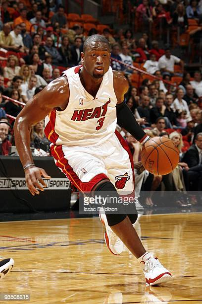 Dwyane Wade of the Miami Heat makes a move to the basket during the game against the New Jersey Nets at American Airlines Arena on November 14 2009...