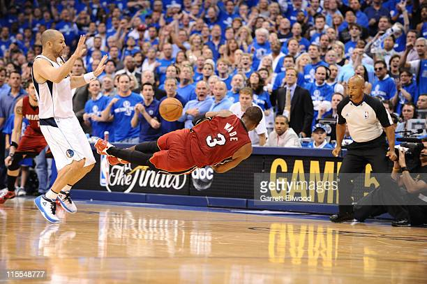 Dwyane Wade of the Miami Heat mishandles the inbound pass against Jason Kidd of the Dallas Mavericks during Game Four of the 2011 NBA Finals on June...