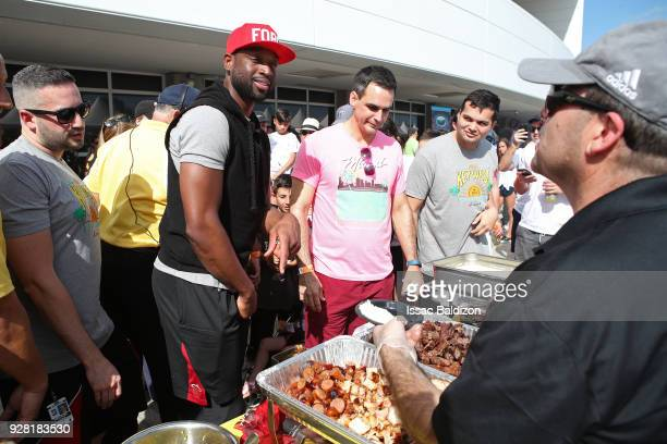 Dwyane Wade of the Miami Heat participates in the 2018 Family Festival at the American Airlines Area on March 4 2018 in Miami Florida NOTE TO USER...