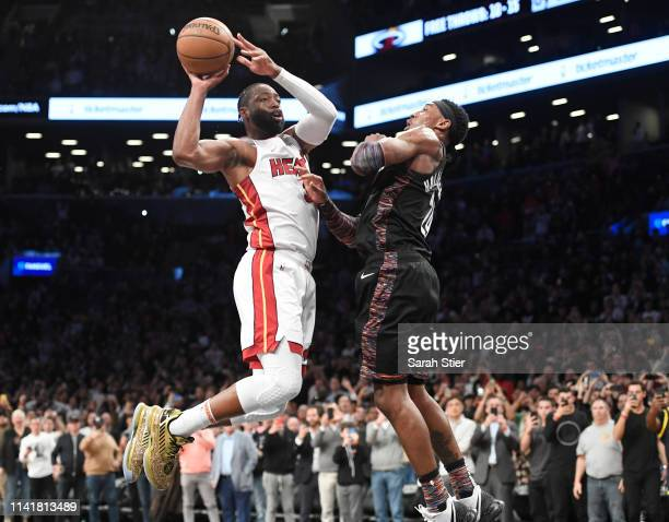 Dwyane Wade of the Miami Heat passes the ball in the final seconds of the game against the Brooklyn Nets at Barclays Center on April 10, 2019 in the...