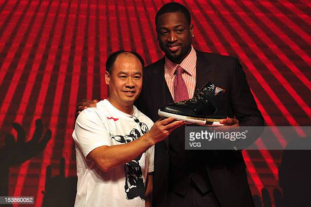 Dwyane Wade of the Miami Heat poses with Li Ning founder and chairman of Li Ning Co during a press conference as he signs a contract with Chinese...