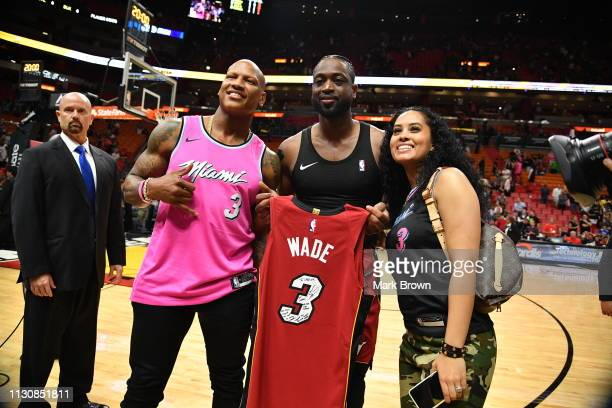 Dwyane Wade of the Miami Heat poses with Pittsburgh Steeler Ryan Shazier and his fiancé Michelle Rodriguez after the game between the Miami Heat and...