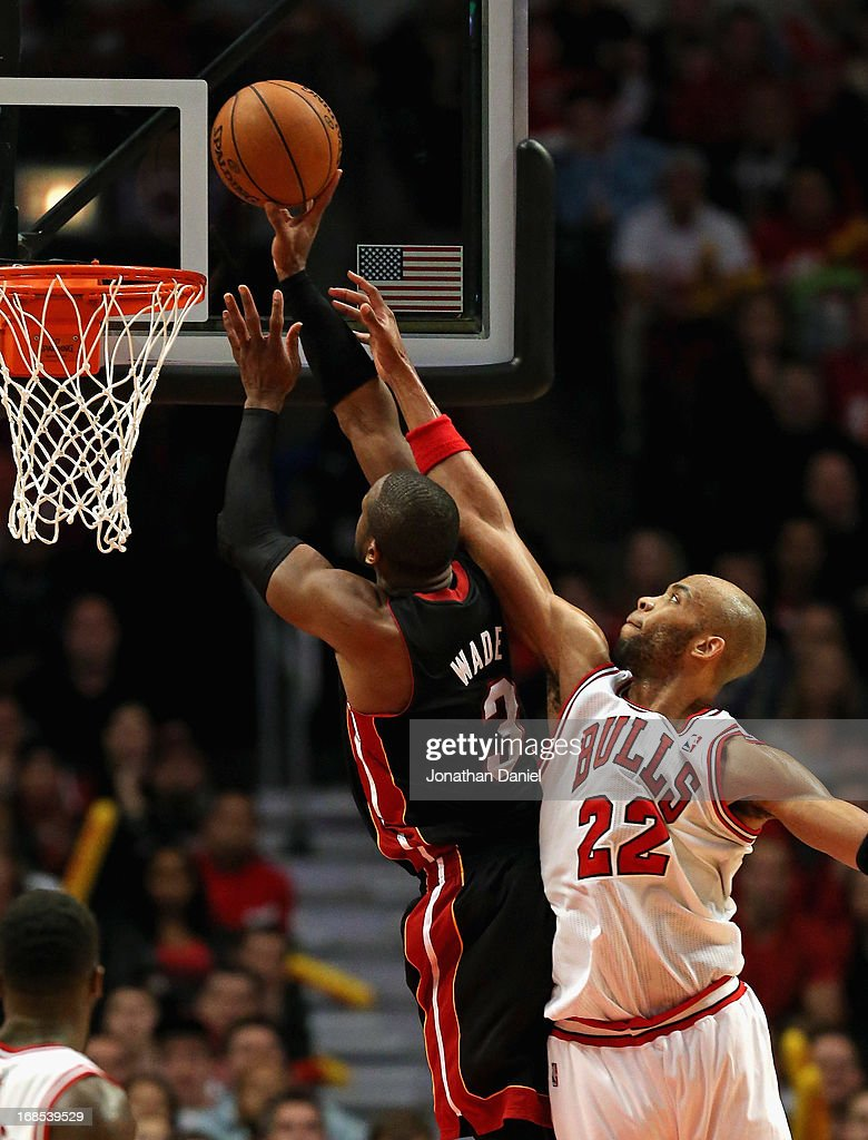 Dwyane Wade #3 of the Miami Heat pus up a shot against Taj Gibson #22 of the Chicago Bulls in Game Three of the Eastern Conference Semifinals during the 2013 NBA Playoffs at the United Center on May 10, 2013 in Chicago, Illinois. The Heat defeated the Bulls 104-94.