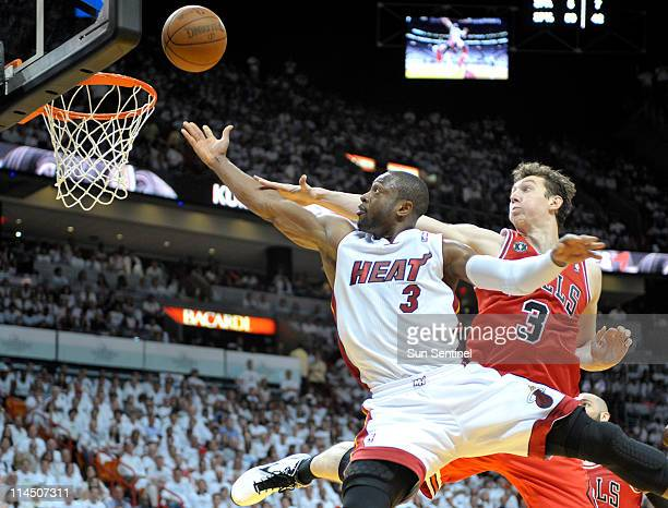 Dwyane Wade of the Miami Heat puts a shot up and over Omer Asik of the Chicago Bulls in the third quarter during Game 3 of the NBA Eastern Conference...
