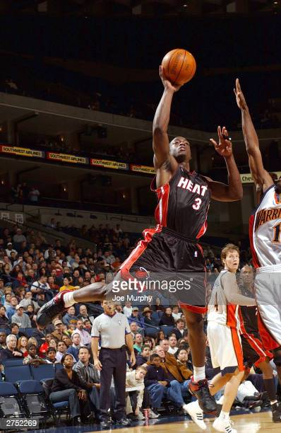 Dwyane Wade of the Miami Heat puts up a layup against the Golden State Warriors during a game on November 21 2003 at the Arena in Oakland in Oakland...