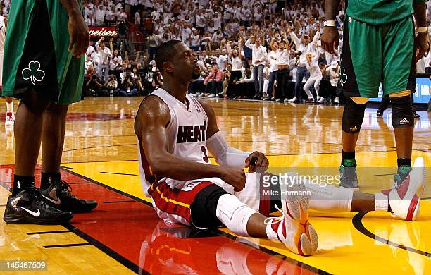 Dwyane Wade of the Miami Heat reacts after he made a basket and drew a foul against Kevin Garnett of the Boston Celtics in overtime of Game Two of...