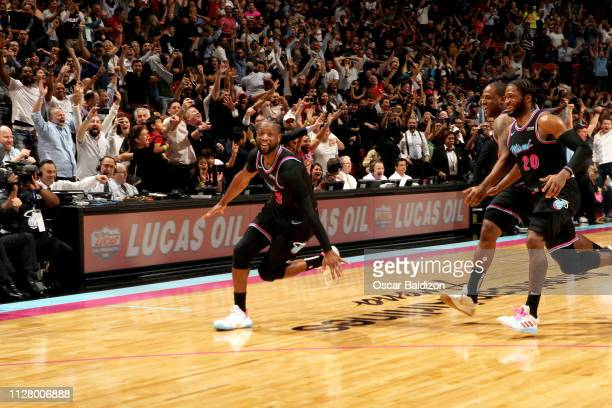 Dwyane Wade of the Miami Heat reacts after hitting the game winning 3 point basket against the Golden State Warriors on February 27 2019 at American...