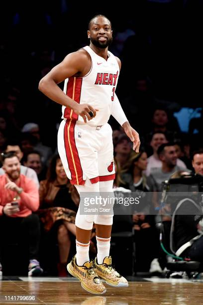 Dwyane Wade of the Miami Heat reacts after making a basket during the first half of the game against the Brooklyn Nets at Barclays Center on April...