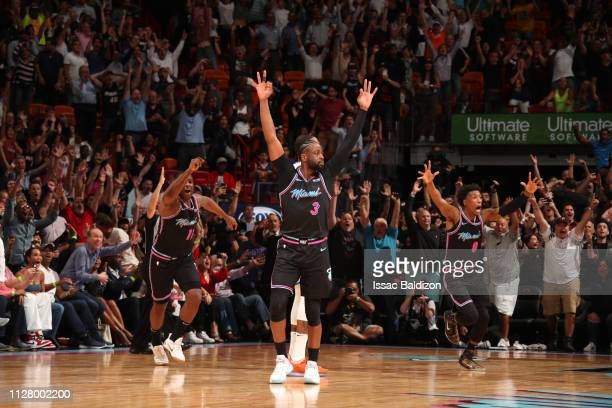 Dwyane Wade of the Miami Heat reacts to hitting the game-winning three-point shot against the Golden State Warriors on February 27, 2019 at American...