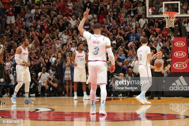 Dwyane Wade of the Miami Heat receives a standing ovation during the game against the Milwaukee Bucks on February 9 2018 at American Airlines Arena...