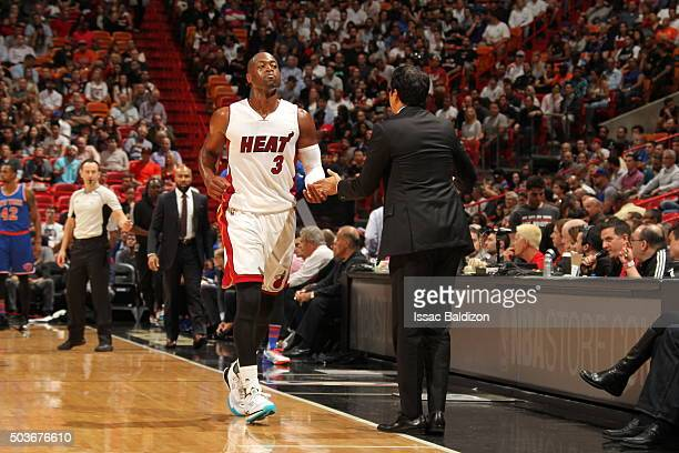 Dwyane Wade of the Miami Heat shakes hands with head coach Erik Spoelstra of the Miami Heat during the game against the New York Knicks on January 6...