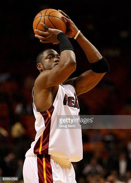 Dwyane Wade of the Miami Heat shoots a free throw while taking on the Charlotte Bobcats at American Airlines Arena on December 8 2008 in Miami...