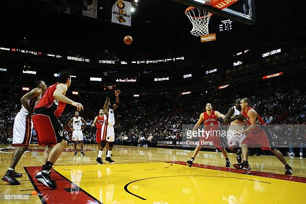 Dwyane Wade of the Miami Heat shoots a freethrow in the second half while taking on the Toronto Raptors at American Airlines Arena on November 19...