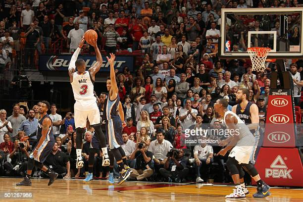 Dwyane Wade of the Miami Heat shoots a jumper against Courtney Lee of the Memphis Grizzlies during the game on December 13 2015 at American Airlines...