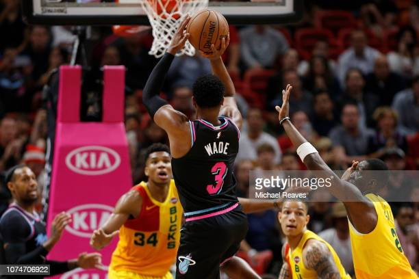 Dwyane Wade of the Miami Heat shoots a jumper against the Milwaukee Bucks at American Airlines Arena on December 22 2018 in Miami Florida NOTE TO...