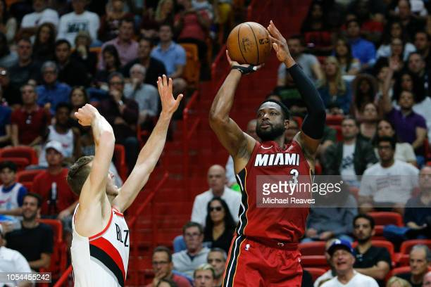 Dwyane Wade of the Miami Heat shoots a jumper against the Portland Trail Blazers during the first half at American Airlines Arena on October 27 2018...