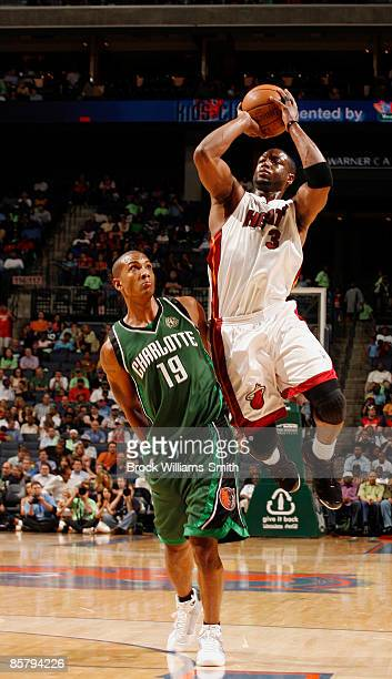 Dwyane Wade of the Miami Heat shoots a jumpshot against Raja Bell of the Charlotte Bobcats on April 3 2009 at the Time Warner Cable Arena in...