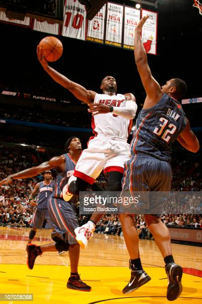 Dwyane Wade of the Miami Heat shoots against Boris Diaw of the Charlotte Bobcats on November 19 2010 at American Airlines Arena in Miami Florida NOTE...