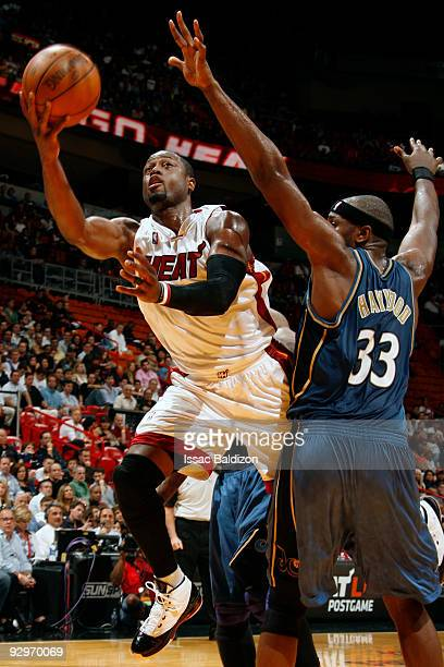 Dwyane Wade of the Miami Heat shoots against Brendan Haywood of the Washington Wizards on November 10 2009 at American Airlines Arena in Miami...