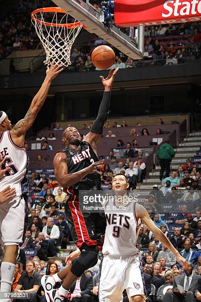 Dwyane Wade of the Miami Heat shoots against Courtney Lee of the New Jersey Nets on March 22 2010 at the IZOD Center in East Rutherford New Jersey...