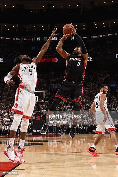 Dwyane Wade of the Miami Heat shoots against DeMarre Carroll of the Toronto Raptors during Game One of the Eastern Conference Semifinals during the...
