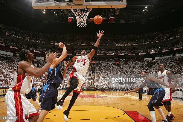 Dwyane Wade of the Miami Heat shoots against Dirk Nowitzki of the Dallas Mavericks during Game Three of the 2006 NBA Finals June 13 2006 at American...