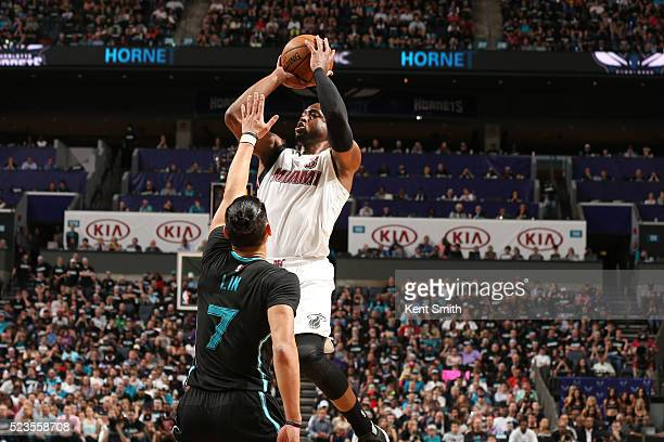 Dwyane Wade of the Miami Heat shoots against Jeremy Lin of the Charlotte Hornets during Game Three of the Eastern Conference Quarterfinals during the...