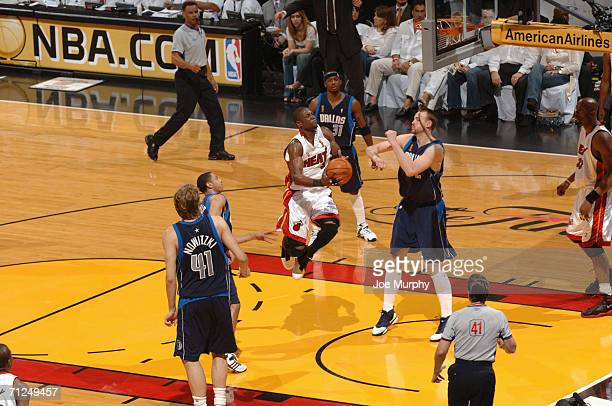 Dwyane Wade of the Miami Heat shoots against Keith Van Horn of the Dallas  Mavericks during 1f7cb7795