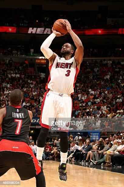 Dwyane Wade of the Miami Heat shoots against the Toronto Raptors on April 11 2015 at American Airlines Arena in Miami Florida NOTE TO USER User...