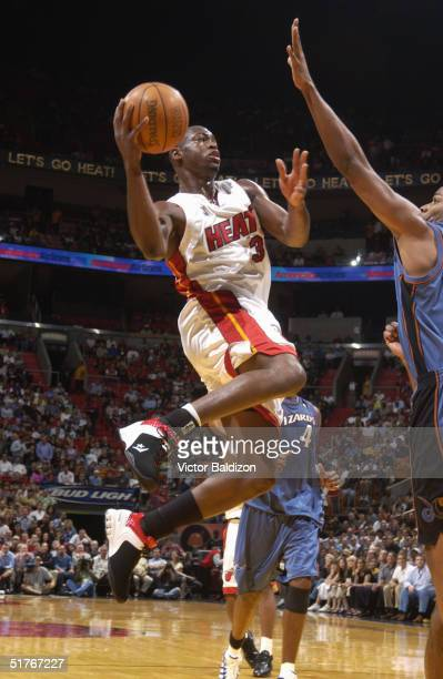 Dwyane Wade of the Miami Heat shoots against the Washington Wizards November 9 2004 at American Airlines Arena in Miami Florida The Heat won 10393...