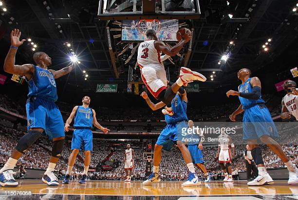 Dwyane Wade of the Miami Heat shoots against Tyson Chandler of the Dallas Mavericks during Game Two of the 2011 NBA Finals on June 2 2011 at the...