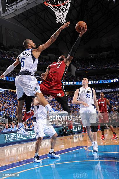 Dwyane Wade of the Miami Heat shoots against Tyson Chandler of the Dallas Mavericks during Game Four of the 2011 NBA Finals on June 7 2011 at the...