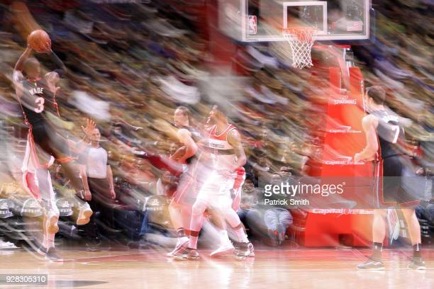 Dwyane Wade of the Miami Heat shoots in front of Markieff Morris of the Washington Wizards during the second half at Capital One Arena on March 6...