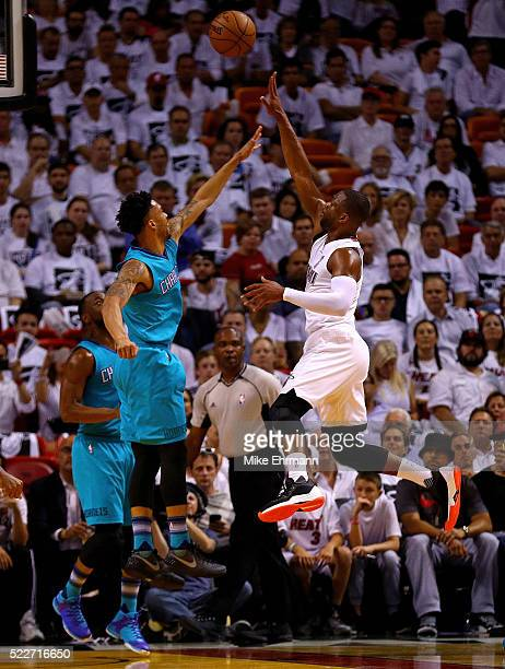 Dwyane Wade of the Miami Heat shoots over Courtney Lee of the Charlotte Hornets during game two of the Eastern Conference Quarterfinals of the 2016...