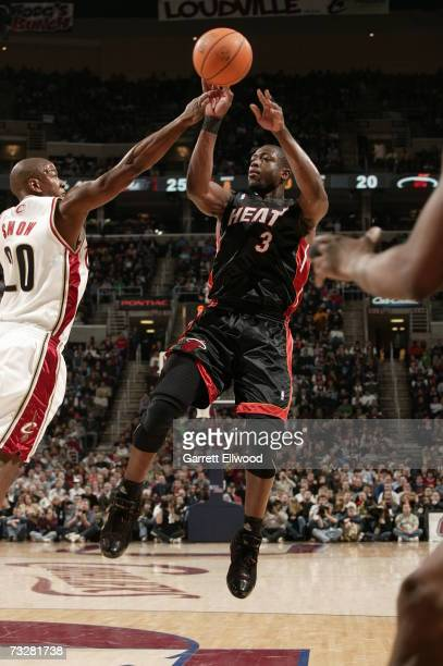 Dwyane Wade of the Miami Heat shoots over Eric Snow of the Cleveland Cavaliers on February 9 2007 at the Quicken Loans arena in Cleveland Ohio NOTE...