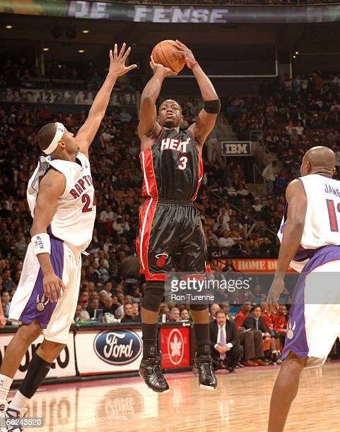 Dwyane Wade of the Miami Heat shoots over Morris Peterson of the Toronto Raptors on November 20 2005 at the Air Canada Centre in Toronto Canada NOTE...