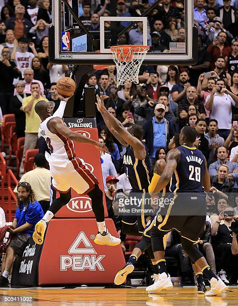Dwyane Wade of the Miami Heat shoots over Rodney Stuckey of the Indiana Pacers to tie the game at American Airlines Arena on January 4 2016 in Miami...