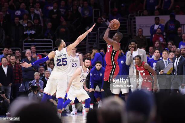 Dwyane Wade of the Miami Heat shoots the ball against Ben Simmons of the Philadelphia 76ers late in the fourth quarter during game two of round one...