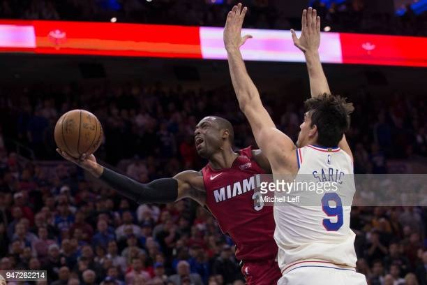 Dwyane Wade of the Miami Heat shoots the ball against Dario Saric of the Philadelphia 76ers in the fourth quarter during Game Two of the first round...