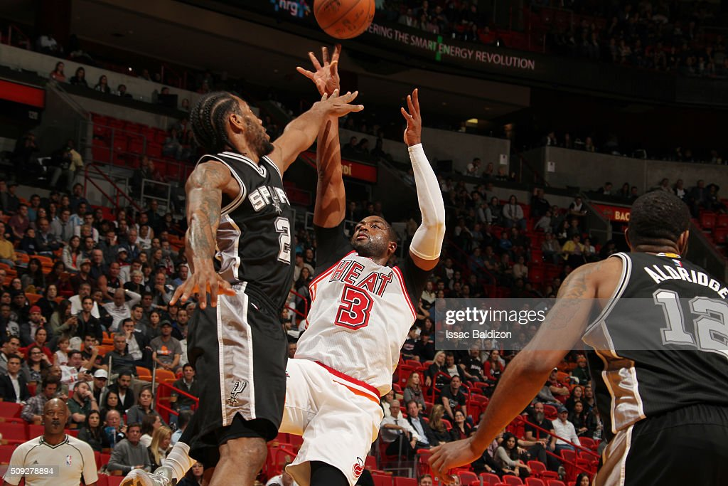 Dwyane Wade #3 of the Miami Heat shoots the ball against Kawhi Leonard #2 of the San Antonio Spurs on February 9, 2016 at American Airlines Arena in Miami, Florida.