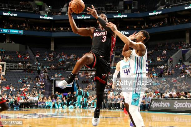 Dwyane Wade of the Miami Heat shoots the ball against the Charlotte Hornets during a preseason game on October 2 2018 at Spectrum Center in Charlotte...
