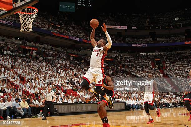 Dwyane Wade of the Miami Heat shoots the ball against the Toronto Raptors in Game Four of the Eastern Conference Semifinals at AmericanAirlines Arena...