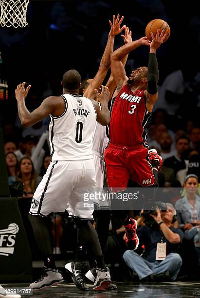Dwyane Wade of the Miami Heat shoots the ball as Andray Blatche of the Brooklyn Nets defends in Game Four of the Eastern Conference Semifinals during...