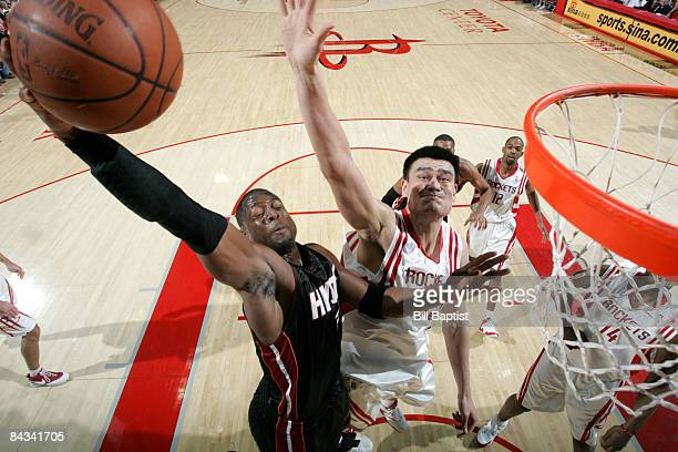 Dwyane Wade of the Miami Heat shoots the ball over Yao Ming of the Houston Rockets on January 17 2009 at the Toyota Center in Houston Texas NOTE TO...