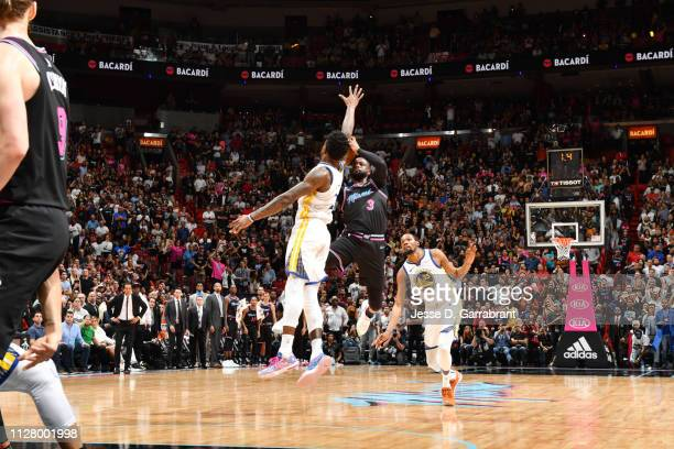 Dwyane Wade of the Miami Heat shoots the game winning three pointer against the Golden State Warriors on February 27 2019 at American Airlines Arena...
